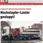 Foto mostra caminhão que leva 2 caminhões e 1 carro